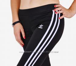 Женские спортивные  штаны, бриджи и шорты Adidas с полосами.