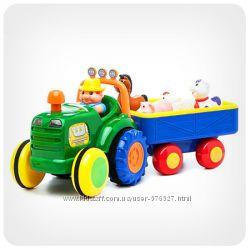 Развивающие игрушки Трактор с трейлером и Трактор фермера Kiddieland