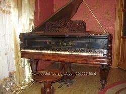 Антикварный рояль 1855 года.