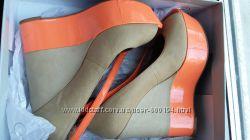 Кожаные туфли на танкетке