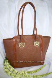 Красивая и стильная сумка.