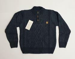 Теплый вязаный свитер под горло для мальчика темно-синего цвета