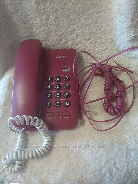 Стационарный красный телефон