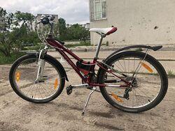 Продам спортивный велосипед на  8-14лет Trek МТ 220 с брызговиками