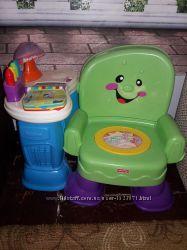 Музыкальное кресло - умный стульчик фирмы fisher price серии Смейся и учись