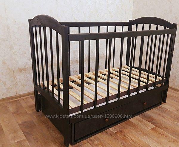 Кроватка дерев. маятник  и шухляда - откидной или опускной бортик Глория