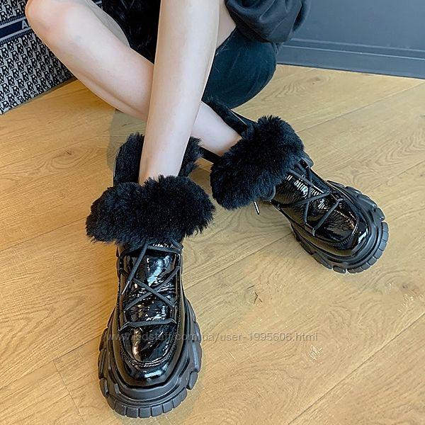 Зимние ботинки на массивной подошве в стиле UGG